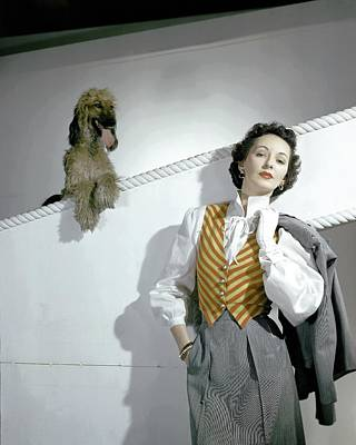 Panting Photograph - A Model Wearing A Wool Suit And Striped Vest by Horst P. Horst