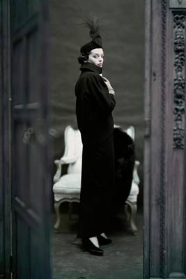 Black Jacket Photograph - A Model Wearing An Adele Simpsons Ensemble by John Rawlings