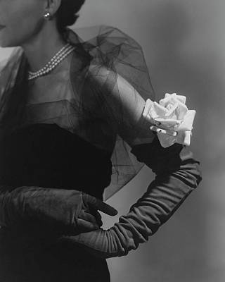 Long Gloves Photograph - A Model Wearing And Velvet Rose by Horst P. Horst