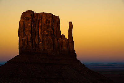 Dusk Photograph - A Monument Of Stone - Monument Valley Tribal Park by Gregory Ballos