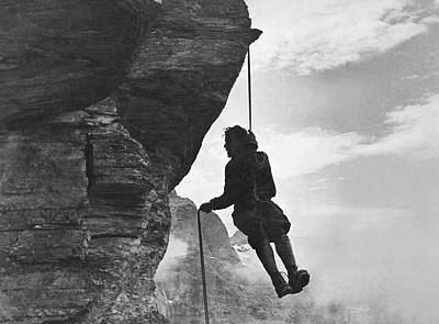 Photograph - A Mountain Climber Rappelling by Underwood Archives