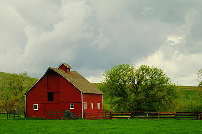 Birds Rights Managed Images - A Neat Red Barn Near Sheridan Wyoming Royalty-Free Image by Jeff Swan