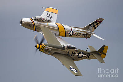 Landmarks Royalty Free Images - A P-51 Mustang And F-86 Sabre Royalty-Free Image by Rob Edgcumbe