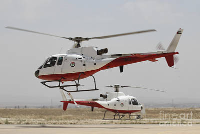 A Pair Of As350 Squirrel Helicopters Print by Ofer Zidon