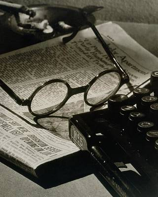 Typewriter Photograph - A Pair Of Glasses On Top Of A Newspaper by Irving Browning