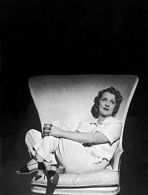 Thoughtful Photograph - A Pensive Woman Curled Up In A Chair by Underwood Archives