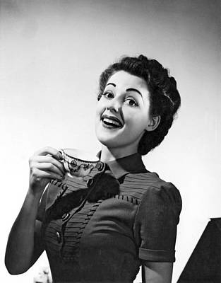 Java Tea Photograph - A Perky Woman Enjoys Her Cup Of Coffee. by Underwood Archives