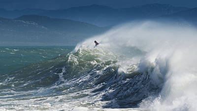 A Person Surfing In The Waves Along The Art Print by Ben Welsh