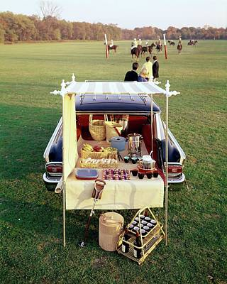 A Picnic Table Set Up On The Back Of A Car Art Print by Rudy Muller