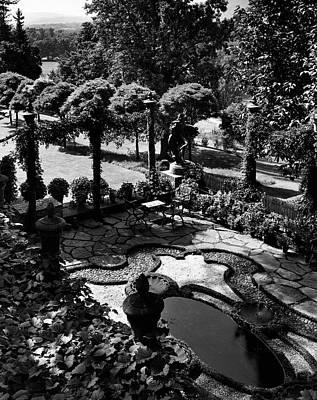 Water Fountain Photograph - A Pond In An Ornamental Garden by Gottscho-Schleisner