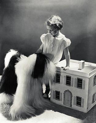 Stuffed Animal Toys Photograph - A Portrait Of A Young Girl And A Dog by Horst P. Horst