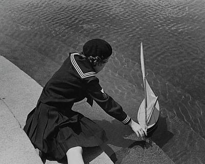 Watercraft Photograph - A Portrait Of A Young Girl With A Sailboat by Lusha Nelson