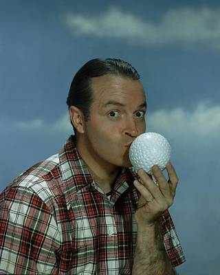 A Portrait Of Bob Hope Kissing A Golf Ball Print by Artist Unknown