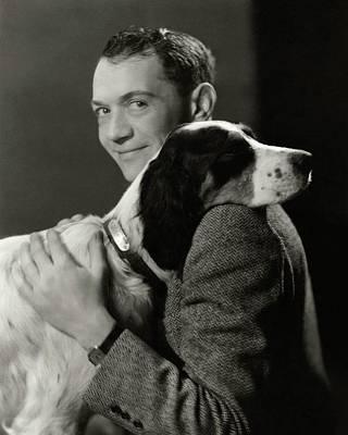 A Portrait Of John Held Jr. Hugging A Dog Art Print by Nickolas Muray