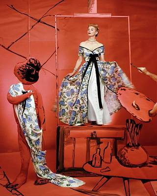A Portrait Of Lisa Fonnsagrives On A Red Set Art Print by Horst P. Horst