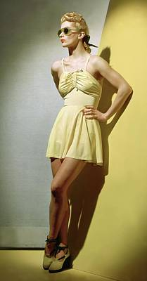 Full-length Portrait Photograph - A Portrait Of Lisa Fonssagrives In A Yellow by Horst P. Horst
