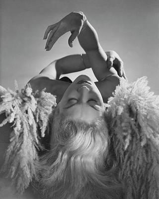 Fashion Model Photograph - A Portrait Of Lisa Fonssagrives Lying by Horst P. Horst