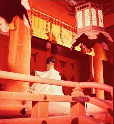 A Priest Praying In A Shinto Shrine Art Print by Nick De Morgoli