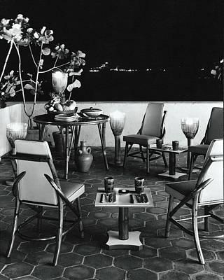 Deck Chair Photograph - A Rattan Dining Set On A City Terrace by Tom Leonard