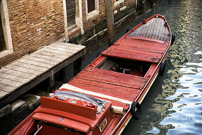 A Red Boat In Venice Print by John Rizzuto