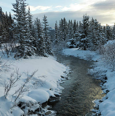 A River Flowing Through A Snow Covered Art Print by Keith Levit