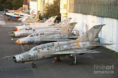 Abandoned Air Plane Photograph - A Row Of Derelict Mig Aircraft by Timm Ziegenthaler