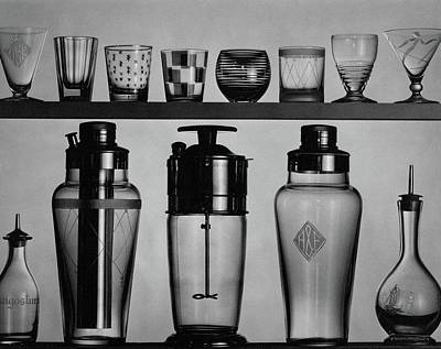Black And White Photograph - A Row Of Glasses On A Shelf by The 3
