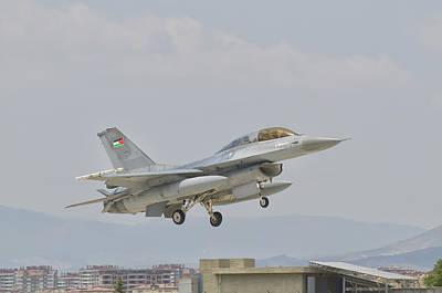 Jordanian Photograph - A Royal Jordanian Air Force F-16 by Giovanni Colla