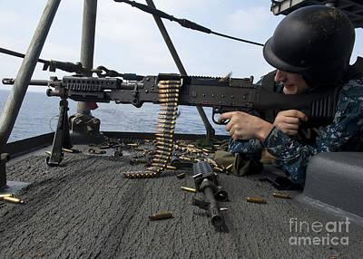 A Sailor Fires An M-240b Machine Gun Print by Stocktrek Images