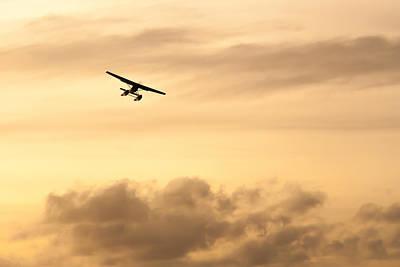 Sunset Photograph - A Seaplane At Sunset by Glenn Martin