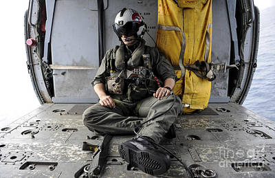 Obscured Face Photograph - A Search And Rescue Swimmer Sits by Stocktrek Images