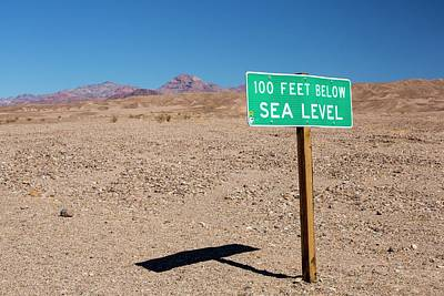 Dry Lake Photograph - A Sign At 100 Feet Below Sea Level by Ashley Cooper