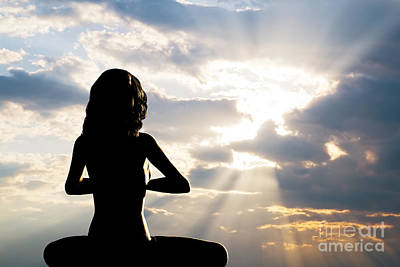 Spirituality Photograph - A Silhouette Of A Woman Sitting In Yoga Position by Michal Bednarek