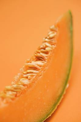 Cantaloupe Photograph - A Slice Of Cantaloupe Melon (detail) by Foodcollection