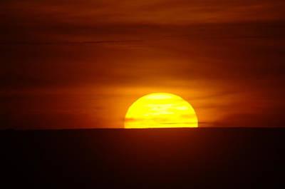 A Slow Sunset Art Print by Jeff Swan