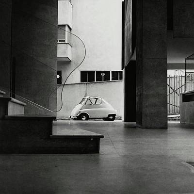 Photograph - A Small Parked Car by Paul Himmel