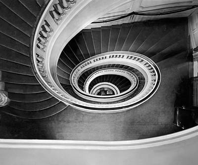 Spiral Staircase Photograph - A Spectacular View Of The Grand Staircase At The New Home Of The by Underwood Archives