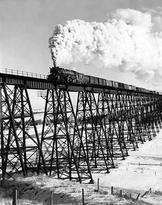Built Structure Photograph - A Steam Engine On Trestle by Underwood Archives