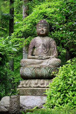 A Stone Buddha Statue In The Grounds Art Print