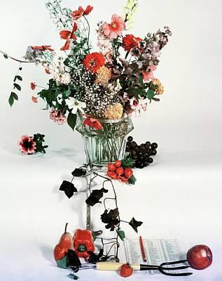 A Studio Shot Of A Vase Of Flowers And A Garden Art Print by Herbert Matter