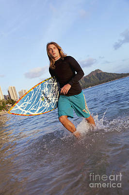 A Surfer Carrying His Surfboard And Walking In Shallow Water_ Waikiki, Oahu, Hawaii, United States Of America Art Print