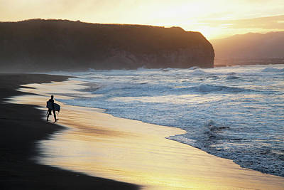 Walking In Tide Photograph - A Surfer Walks To The Water At Sunrise by Carl Bruemmer