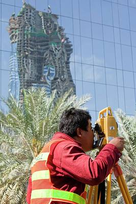Tripod Photograph - A Surveyor On A Construction Project by Ashley Cooper