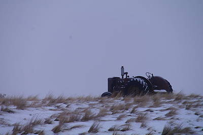A Tractor Fading To The Snow  Art Print by Jeff Swan