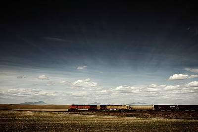 Freight Train Photograph - A Train Rolls Across The American by Todd Korol