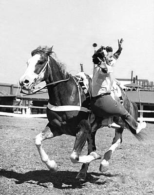 Cowgirl Photograph - A Trickriding Cowgirl by Underwood Archives