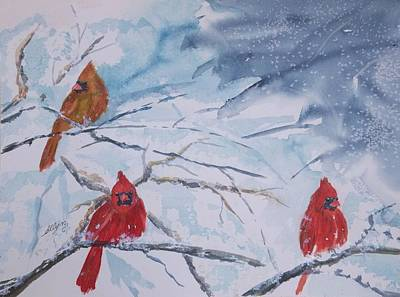 A Trio Of Cardinals Nestled In Snow Covered Branches Art Print by Ellen Levinson