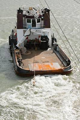 Tug Boat Photograph - A Tug Boat Towing A Jack Up Barge by Ashley Cooper