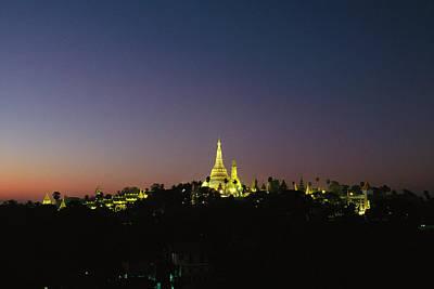 Photograph - A Twilight View Of The Shwedagon Pagoda by Steve Winter