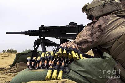 A U.s. Marine Fires An M2 .50 Caliber Art Print